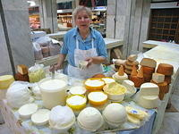 Buying fresh cheese at the market.